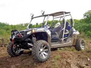 2012.polaris.rzr4-le.blue.front-left.parked.on-dirt.jpg