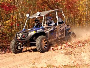 2012.polaris.rzr4-le.blue.front-left.riding.on-trail.jpg