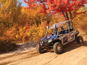 2012.polaris.rzr4_.with-accessories.blue_.front-left.riding.on-dirt.jpg