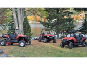 2012.polaris.rzr570.red_.front_.parked.by-other-rzrs.jpg