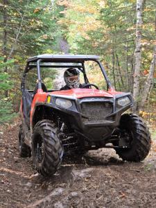 2012.polaris.rzr570.red_.front_.riding.on-trails.jpg