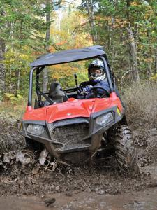 2012.polaris.rzr570.red_.front_.riding.through-mud.jpg