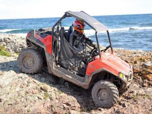 2012.polaris.rzr570.red_.right_.riding.on-rocks.jpg