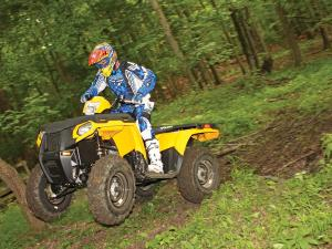 2012.polaris.sportsman500ho.yellow.front-left.jumping.in-air..jpg