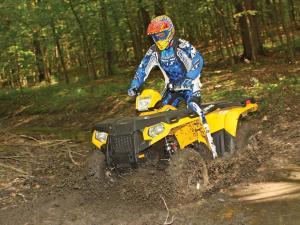 2012.polaris.sportsman500ho.yellow.front-left.riding,through-mud..jpg