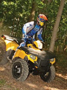 2012.polaris.sportsman500ho.yellow.front-right.riding,through-woods..jpg