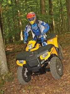 2012.polaris.sportsman500ho.yellow.front.riding,through-woods..jpg