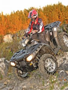 2012.polaris.sportsman550.black.front-left.riding.down-rocks.jpg