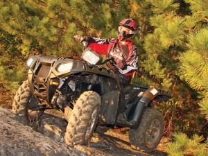 2012.polaris.sportsman550.black.front-left.riding.on-rocks.jpg