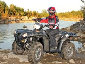 2012.polaris.sportsman550.black.left.riding.by-water.jpg