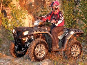 2012.polaris.sportsman550xp.silver.front-left.riding.on-path.jpg