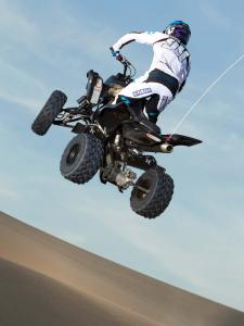2012.yamaha.raptor700.black.rear.jumping.in-air.jpg