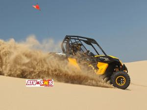 2013.can-am.maverick1000r-x.yellow.right_.riding.on-sand.jpg