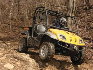 2013.cub-cadet.volunteer4x4efi.yellow.front-right.riding.over-rocks.JPG