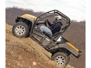 2013.cub-cadet.volunteer4x4efi.yellow.left.riding.up-hill.jpg