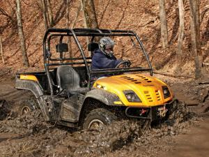 2013.cub-cadet.volunteer4x4efi.yellow.right_.riding.through-mud.JPG