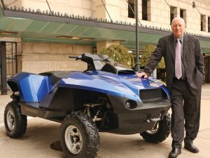 2013.gibbs-sports.quadski.amphibious-atv.blue.parked.next-to-inventor-alan-gibbs.JPG