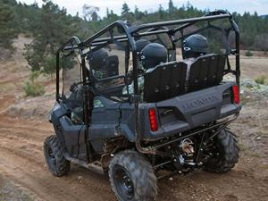 2013.honda.pioneer700-4.camo.rear-left.riding.on-trail.jpg