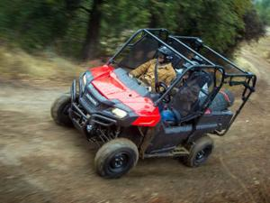 2013.honda_.pioneer700-4.red_.front-left.riding.on-trail.jpg