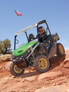 2013.john-deere.gator-rsx850i.green.front-left.riding.down-rocks.jpg
