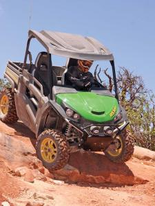 2013.john-deere.gator-rsx850i.green.front.riding.over-rocks.jpg