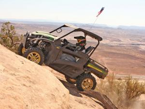 2013.john-deere.gator-rsx850i.green.left.riding.up-rocks.jpg