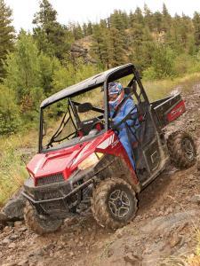 2013.polaris.ranger-xp900.red_.front-left.riding.through-mud.jpg