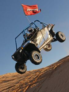 2013.polaris.rzr-jagged-x.blue.front-left.jumping.in-air.JPG