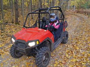 2013.polaris.rzr570.red.front-left.riding.on-trail.JPG