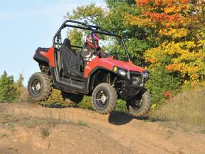 2013.polaris.rzr570.red.front-right.jumping.in-air.JPG