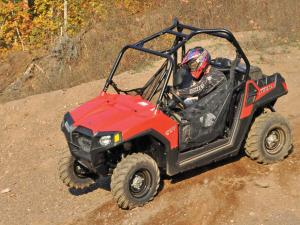 2013.polaris.rzr570.red.front-right.riding.on-dirt.JPG