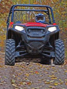 2013.polaris.rzr570.red.front.riding.on-trail.JPG