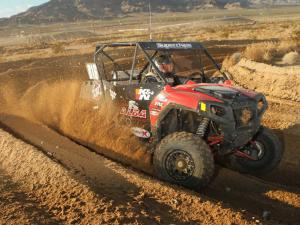 2013.polaris.rzr.red.front-right.racing.on-track.jpg