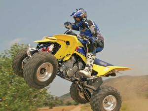 2013.suzuki.ltr450.yellow.left.jumping.in-air.JPG