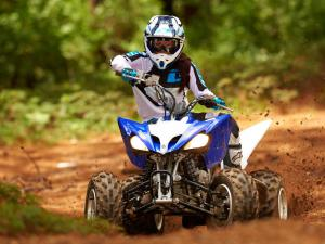 2013.yamaha.raptor250.blue_.front_.riding.on-trail.JPG