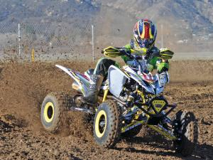 2013.yamaha.raptor250triumph.white.front-right.riding.on-track.jpg