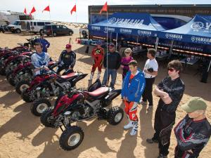 2013.yamaha.raptor700r.line-up.parked.on-sand.jpg