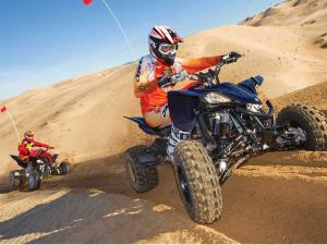 2013.yamaha.yfz450r.black.front.riding.with-raptor700r.on-sand.jpg