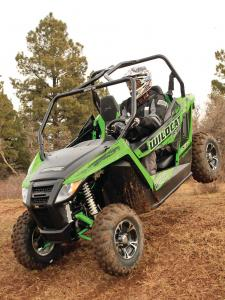 2014.arctic-cat.wildcat-trail-xt.front-left.green.riding.on-dirt.JPG