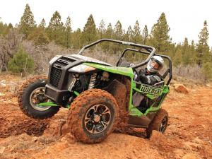 2014.arctic-cat.wildcat-trail-xt.front-left.green.riding.over-rocks.JPG