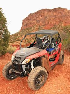 2014.arctic-cat.wildcat-trail-xt.front-left.red.riding.on-rocks.JPG