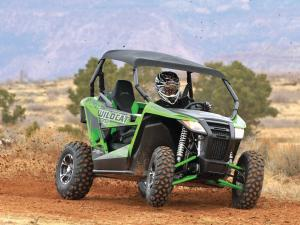 2014.arctic-cat.wildcat-trail-xt.front-right.green.riding.on-dirt.JPG