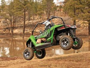 2014.arctic-cat.wildcat-trail-xt.left.green.jumping.in-air.JPG