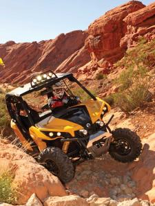 2014.can-am.maverick.yellow.front.riding.over-rocks.jpg