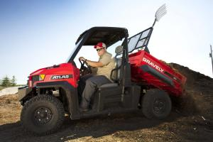 2014.gravely.atlas-jsv-utility-vehicle.red.left.dumping-dirt.on-farm.jpg