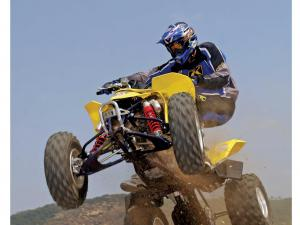 2014.honda-trx250r.yellow.front_.jumping.in-air.featured-image.JPG