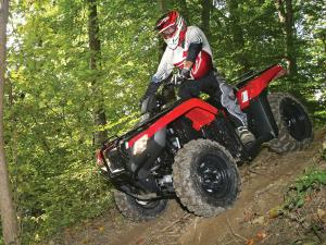 Honda Fourtrax Rancher Red Left Riding In Woods on Atv Four Ers