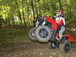 2014.honda_.fourtrax-rancher.red_.left_.riding.wheelie.jpg