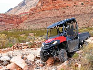 2014.honda.pioneer700.red.front-left.riding.over-rocks.JPG