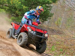 2014.kawasaki.brute-force300.red.front-right.riding.on-trail.JPG